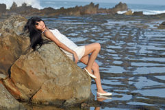 Asian woman lay on rock Royalty Free Stock Image