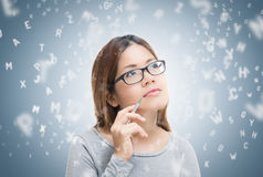 Asian woman learning Royalty Free Stock Image