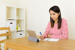 Asian woman learning through digital tablet Stock Photography
