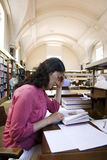 Asian woman in the library. One East Asian woman study in the local library Royalty Free Stock Photos