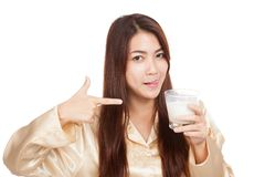 Asian woman  licking her lip point to glass of milk Stock Photo