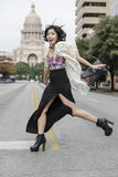 Asian Woman in lifestyle locations crossing the street street in front of Capital building in Austin, Texas Royalty Free Stock Photos