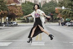 Asian Woman in lifestyle locations crossing the street street in front of Capital building in Austin, Texas Stock Photo