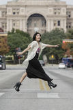 Asian Woman in lifestyle locations crossing the street street in front of Capital building in Austin, Texas Royalty Free Stock Photo