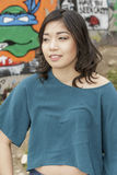 Asian Woman in lifestyle locations by Public Grafitti Wall Royalty Free Stock Photo