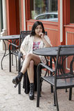 Asian Woman in lifestyle locations sitting at a table on the street Stock Photos