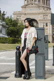 Asian Woman in lifestyle locations standing in front of Capital building in Austin, Texas Royalty Free Stock Images