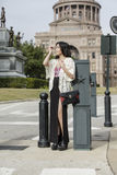 Asian Woman in lifestyle locations standing in front of Capital building in Austin, Texas Stock Photo