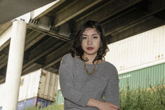 Asian Woman in lifestyle locations under a train track overpass Stock Image
