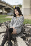 Asian Woman in lifestyle locations under a train track overpass Stock Images