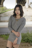 Asian Woman in lifestyle locations under a train track overpass Royalty Free Stock Photo
