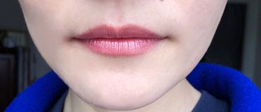 An asian woman lip close-up. An chinese woman lip close-up with makeup on Royalty Free Stock Photo