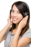 Asian woman listen music with headphone Royalty Free Stock Photography