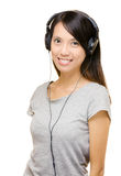 Asian woman listen music with headphone Stock Image