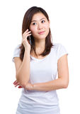 Asian woman listen to cellphone Royalty Free Stock Image