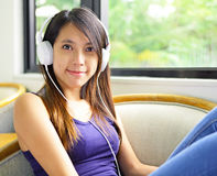 Asian woman listen to music Royalty Free Stock Image