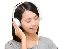 Asian woman listen to music Stock Photo
