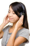 Asian woman listen to music Stock Image