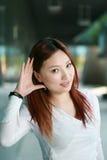 Asian woman listening gossip close up Stock Photos