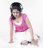 Asian woman listening to music Stock Photography