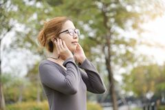 Asian woman is listening to the music. royalty free stock images