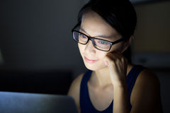 Asian woman look at computer screen Stock Photo