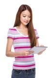 Asian woman look at digital tablet Stock Photo
