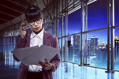 Asian woman look at document Royalty Free Stock Photos