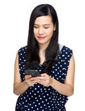 Asian woman look at mobile phone Stock Photos
