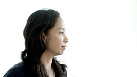 Asian woman looking away, think about future, thoughtful face Royalty Free Stock Photo