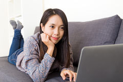Asian woman looking at computer screen Stock Image