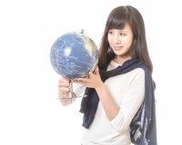 Asian woman looking at globe Stock Photo