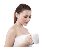 Asian woman looking at her cup Royalty Free Stock Photography
