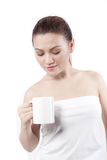 Asian woman looking at her cup and smiling Royalty Free Stock Photography