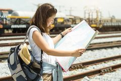 Asian women looking a map for traveling by train. Asian woman looking a map for traveling by train. Long weekend concept stock photos