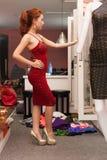 Asian woman looking mirror shopping choosing Stock Photos