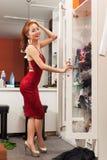 Asian woman looking mirror shopping choosing Royalty Free Stock Photo