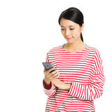 Asian woman looking at mobile phone Stock Image