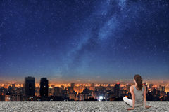 Asian woman looking on night city Stock Photography