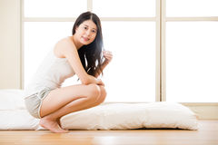 Asian woman looking radiant wake up in early morning light. Asian woman looking radiant wake up in the early morning light, bedroom background stock photography
