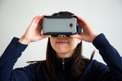 Asian Woman looking though vr Stock Photography