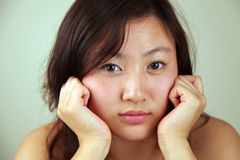 Asian woman looking at viewer Royalty Free Stock Photos