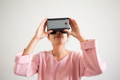 Asian Woman looking vr device Stock Photo