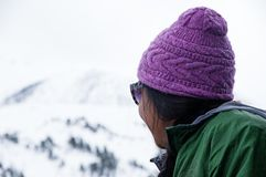 Asian Woman Looks Up At Mountain stock photography