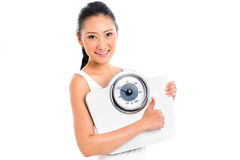 Asian woman losing weight - scale Royalty Free Stock Image