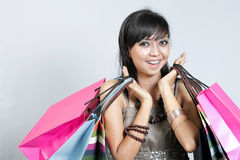 Asian woman with a lot of shopping bags smilling Royalty Free Stock Photos