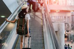 Asian Woman With Luggage Traveling at Airport stock image