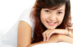 Asian woman lying on the bed Royalty Free Stock Images