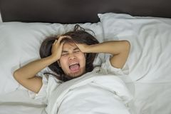 Asian woman lying in bed late at night, young female sleep in bedroom at home stock images