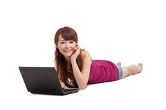 Asian woman lying down with laptop Royalty Free Stock Photography